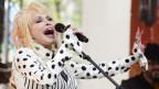 Dolly Parton singend.