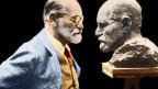 Sigmund Freud betrachtet eine Büste von sich.