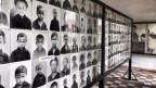 Photos der Ermordeten in der Gedenkstätte S21, einem ehemaligen Gefängnis der Roten Khmer in Phnom Penh.